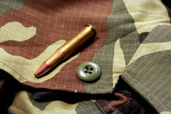 Camouflage. Camou shirt and bullet Stock Images