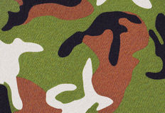 Camouflage background. In green brown black and white colours stock photo