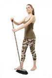 Camouflage broom Royalty Free Stock Photo