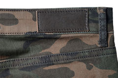 Camouflage brown and green denim military textile background with empty label Royalty Free Stock Images