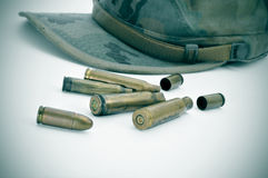 Camouflage cap and bullets Stock Photo