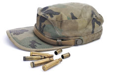 Camouflage cap and empty bullets Royalty Free Stock Image