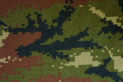 Camouflage cloth pattern. Large seamless image of cloth printed with military camouflage pattern Stock Images