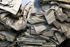 Camouflage clothing green sampling of camouflage jackets in a store. A camouflage clothing green sampling of camouflage jackets in a store stock image