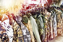 Camouflage clothing for hunters in shop stock photography
