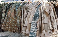 Camouflage clothing. Sampling of camouflage jackets in a store. Camouflage clothing stock photos