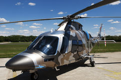 Camouflage colored helicopter Royalty Free Stock Image