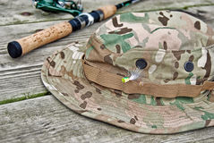 Camouflage fish hat with pole Stock Photos