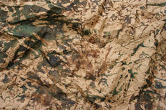 Camouflage folded paper Royalty Free Stock Image