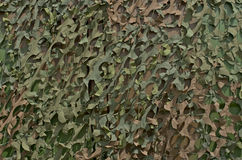 Camouflage grid. Fragment of a camouflage grid hiding a military vehicle Stock Photo