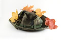 Camouflage hat with leaves Royalty Free Stock Photo