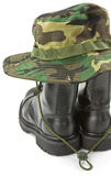 Camouflage hat and military boots Royalty Free Stock Photos