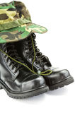 Camouflage hat and military boots Stock Photo