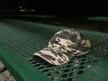 Camouflage Hat on Park Picnic Table Stock Image