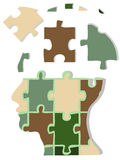 Camouflage jigsaw head. The concept of jigsaw head Royalty Free Stock Photography