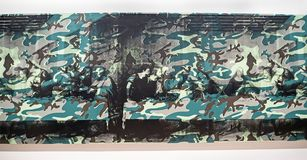 Andy Warhol--From A To B And Back Again at Whitney Museum. Camouflage Last Supper of 1986 by Andy Warhol, is an experiment of overlaying a camouflage pattern stock photos