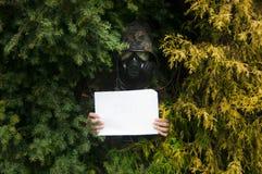 Camouflage met teken Stock Foto