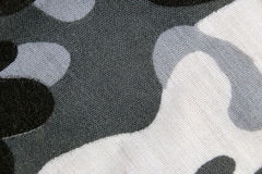 Camouflage pattern of the fabric in macro style. Stock Image