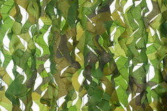Camouflage pattern net for hiding, disguising. Detailed texture. Closeup camouflage pattern net for hiding, disguising. Detailed texture of leaf on white royalty free stock photography