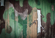 Camouflage pattern. Old Camouflage pattern on Wood background Stock Photo
