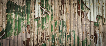 Camouflage pattern. Old Camouflage pattern on Wood background Royalty Free Stock Photography