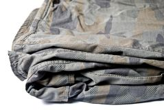 Camouflage pattern trousers. Folded Camouflage pattern trousers. Isolated on white Stock Images