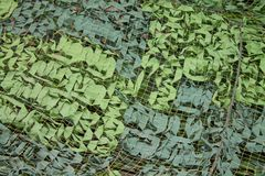 Texture camouflage mesh close-up as background royalty free stock images