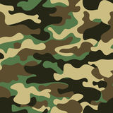 Camouflage seamless pattern background. Classic clothing style masking camo repeat print. Green brown black olive colors. Forest texture. Design element. Vector Royalty Free Stock Photos