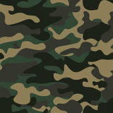 Camouflage seamless pattern background. Classic clothing style masking camo repeat print. Green brown black olive colors Royalty Free Stock Photography
