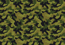 Camouflage seamless pattern. Camouflage background with a seamless design. Woodland style vector illustration Royalty Free Stock Photography