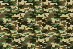Camouflage seamless pattern background. Horizontal seamless banner. Classic clothing style masking camo repeat print. Green brown. Black olive colors forest Royalty Free Stock Image
