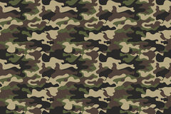 Camouflage seamless pattern background. Horizontal seamless banner. Classic clothing style masking camo repeat print. Green brown Royalty Free Stock Photo