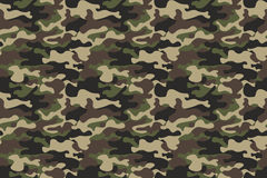 Camouflage seamless pattern background. Horizontal seamless banner. Classic clothing style masking camo repeat print. Green brown. Black olive colors forest Stock Photos