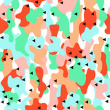 Camouflage seamless pattern in a blue, green and orange colors with triangles. Stock Photography