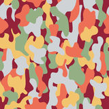 Camouflage seamless pattern in a burgundy, light green, yellow and light red colors. Stock Image
