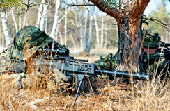 Camouflage sniper in the wood Stock Images