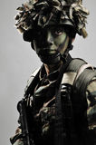 Camouflage soldier fully equipped Stock Images