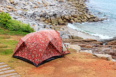 Camouflage Tent in Camping Site on Seashore Stock Photos
