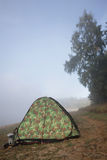 Camouflage tent in the wilderness Stock Photos