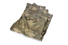 Camouflage trousers. Folded trousers with a camouflage pattern on a white background Royalty Free Stock Photos
