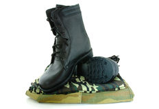 Camouflage uniform and two army boots. Camouflage uniform and black army leather boots Royalty Free Stock Image