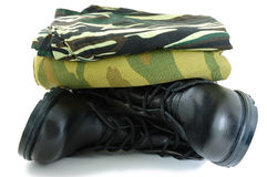 Camouflage uniform and two army boots. Camouflage uniform and black army leather boots Stock Photography