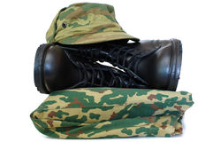 Camouflage uniform and two army boots. Stock Images
