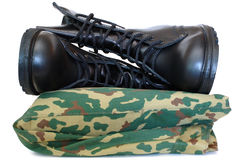 Camouflage uniform and two army boots. Royalty Free Stock Photo