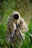 Camouflage wildlife photographer in the ghillie suit. Working in the wild Royalty Free Stock Photography