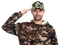 Camouflaged. A man dressed with camouflaged uniform stock photography
