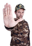 Camouflaged. A man dressed with camouflaged uniform, giving a command Royalty Free Stock Photography