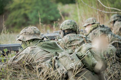 Camouflaged army soldiers with guns Stock Image