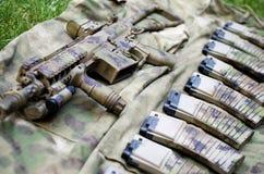 Camouflaged assault rifle Stock Photos