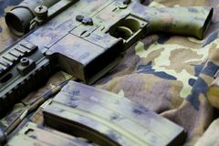 Camouflaged assault rifle Royalty Free Stock Image
